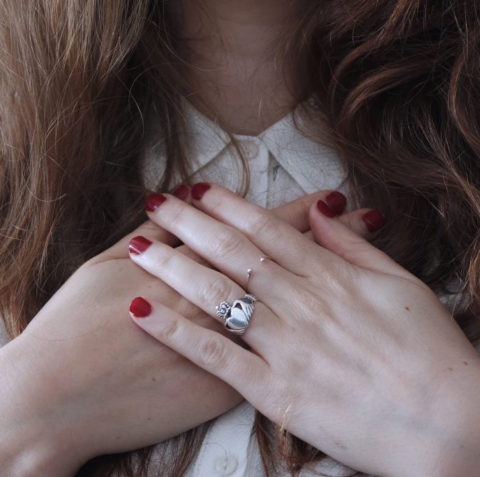 Woman with her hands over her heart